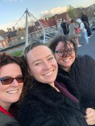 Howest's Head of International Office Isabelle Pertry with Furman's Nancy Georgiev & Caitlynne GoodlettIn Kortrijk Belgium, showing them the bridge that resembles one in Greenville, South Carolina